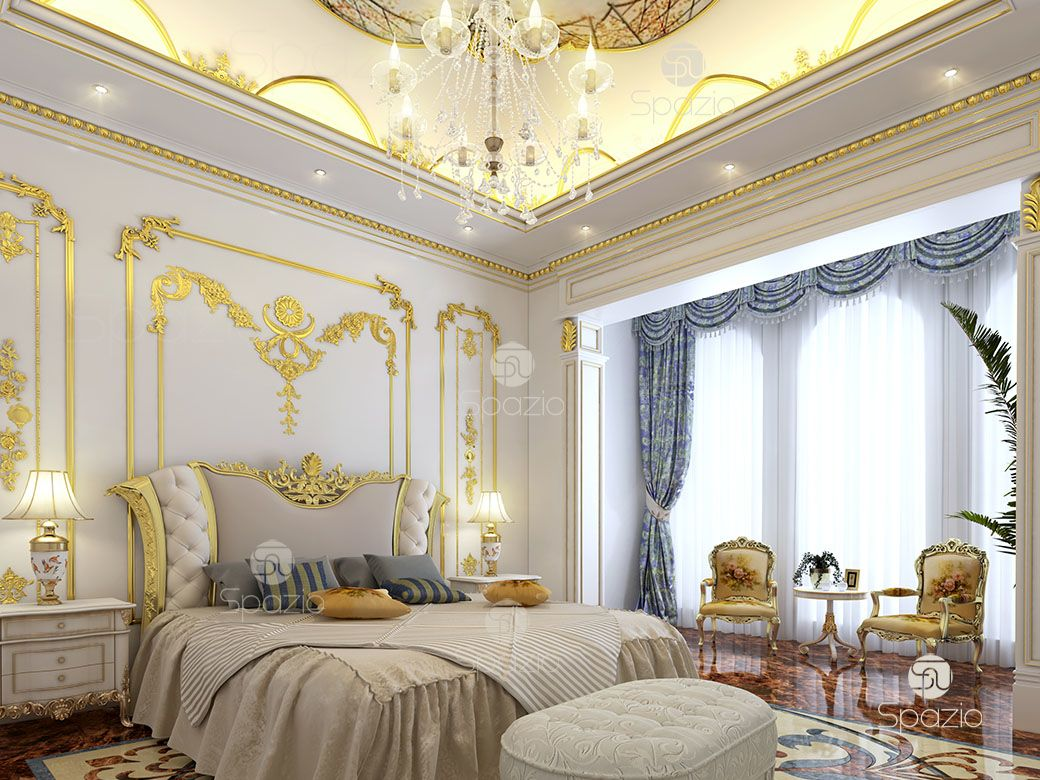 Royal bedroom with a huge bed, gold decor for the owners
