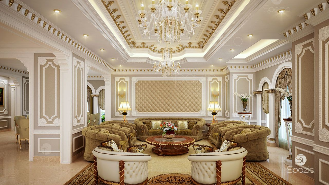 A luxurious classic seating area with comfortable sofas, large bright chandeliers and white, brown, beige, gold decor.
