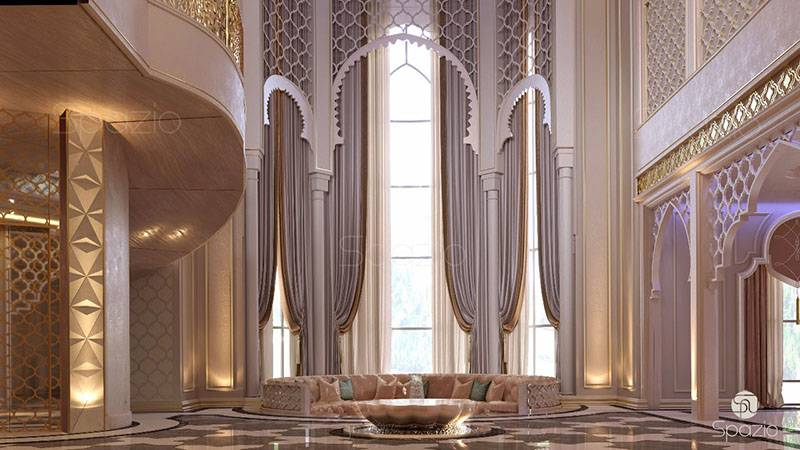 an impressive entrance area in a large house with high ceilings with the use of custom-made pattern and interior fountain.