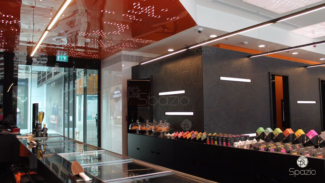 The combination of red, white and black colors creates a unique cafe space