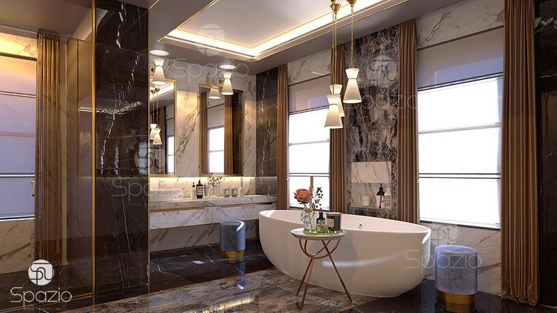Main bathroom of the house made with marble and golden decorative lines on the walls and the floor.