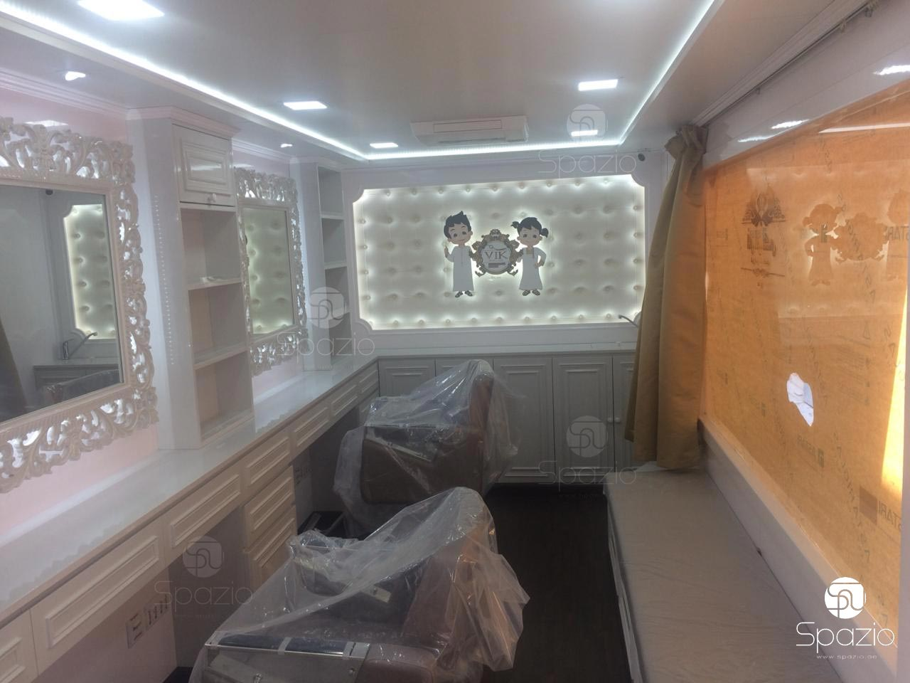 Inside of kids hairdresser truck, made in white color and classical luxury style.